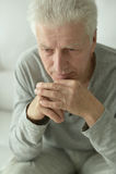 Sad senior man at home Royalty Free Stock Photos