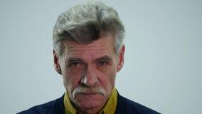 Sad senior man isolated on white background. Crying. Close up studio portrait.  stock video