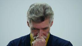 Sad senior man isolated on white background. Crying. Close up studio portrait.  stock video footage