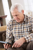 Sad Senior Man Looking At Photograph. In Frame Stock Images