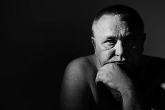 Sad senior man over black Stock Photography
