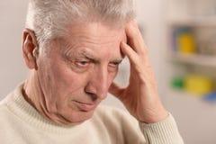 Sad senior man Stock Photos