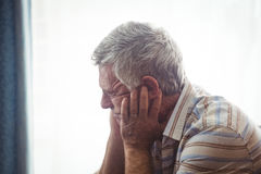 Sad senior man sitting Stock Photo