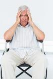 Sad senior man sitting in wheelchair Stock Photos