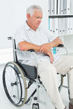 Sad senior man sitting in wheelchair Royalty Free Stock Image