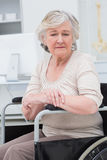 Sad senior patient sitting in wheelchair Stock Photos