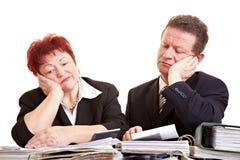 Sad senior people with files Stock Image