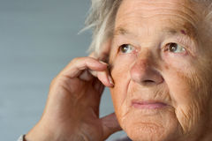 Sad senior woman stock photography