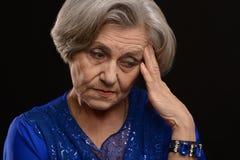 Sad senior woman Stock Photos