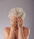 Sad senior woman covering her face Royalty Free Stock Photo