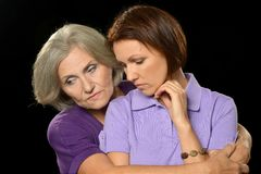 Sad Senior woman with daughter Stock Photo