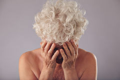 Sad senior woman on grey background Stock Photography