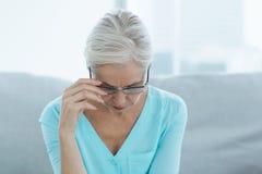 Sad senior woman at home Stock Photos