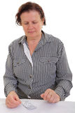 Sad senior woman with the medicine. Senior woman looking at medication Royalty Free Stock Photos