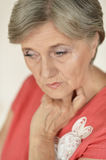 Sad senior woman Stock Images