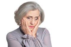 Portrait of sad senior woman on white background stock photo