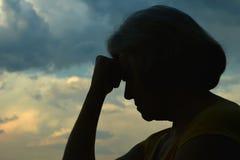 Sad senior woman Stock Photo