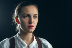 Sad serious woman. In white blouse on black background royalty free stock photo