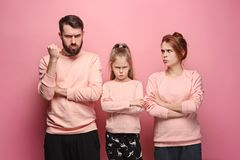 The sad family on pink Royalty Free Stock Images
