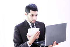 Sad shocked arab business man with tablet and laptop Royalty Free Stock Photography