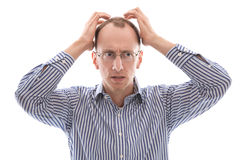Sad and shocked bald isolated man in blue shirt. Stock Photos