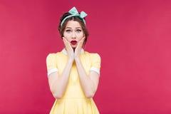 Sad shocked pinup girl in yellow dress Royalty Free Stock Photos