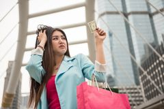 Sad shopaholic girl have one dollar left stock images