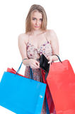 Sad shopper girl with bags and empty wallet. As overspending concept isolated on white background with copyspace Royalty Free Stock Photography