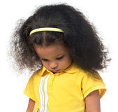 Sad or shy african american small girl. Looking down isolated on white Royalty Free Stock Photography
