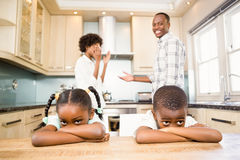 Sad siblings against parents arguing Stock Photos