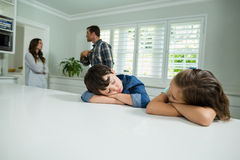 Sad siblings listening their parents having an argument Royalty Free Stock Photos
