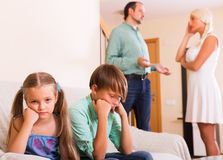 Sad siblings and quarrel parents Stock Photo