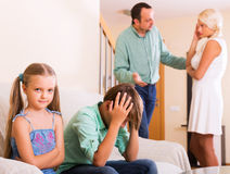 Sad siblings and quarrel parents Stock Photography