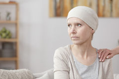 Sad sick woman. With lung cancer sitting at home with friend stock photos
