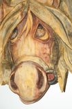 A sad sight horse. Pensive animal on a wooden figure stock photography