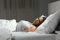 Sad single woman missing her husband in the night stock photography