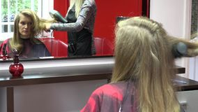 Sad single woman at personal stylist salon make haircut. 4K stock footage