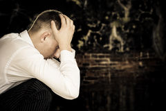 Sad sitting businessman royalty free stock photos
