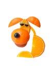 Sad sitting dog made of orange Royalty Free Stock Photography