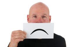 SAD skallig man med smiley arkivfoto