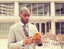 Sad skeptical unhappy serious man talking texting on phone Stock Photos