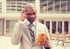 Sad skeptical unhappy serious man talking texting on phone Stock Photos