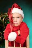 Sad small boy in santa hat Stock Photos