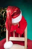 Sad small boy in santa hat Royalty Free Stock Image