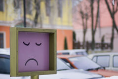 Sad smile. Painted on a street Stock Image