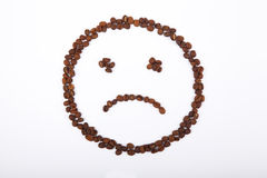 Sad smiley of coffee. Unhappy Smiley laid out from coffee beans Stock Photo