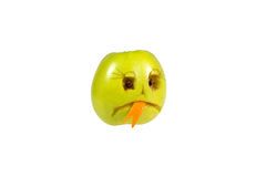 Sad smiley evil out of the apple. Feelings, attitudes and emotio Royalty Free Stock Photos