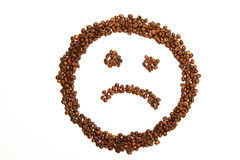 Sad smiley made of coffee beans Royalty Free Stock Photo