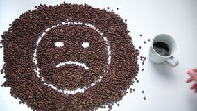 Sad smiley made of coffee beans becoming happy stock video footage