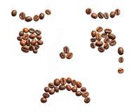 Sad smiley made of coffee beans on white Royalty Free Stock Photos